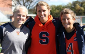 Syracuse players (from left) Heather Wentz (Unionville), Amy Cross (Upper Dublin) and Kasey Mock (Pottstown) helped the Orange tie Delaware, 14-14, Saturday in a Fall Ball game at Radnor