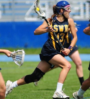 Shoreham-Wading River (NY) senior Alex Fehmel, a Fairfield signee and multiple state champion with the Long Island power, has helped thrust the use of protective headgear into the limelight