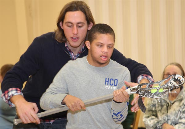 Brett Manney teaches Melmark student (Photos courtesy of Phila. Wings)