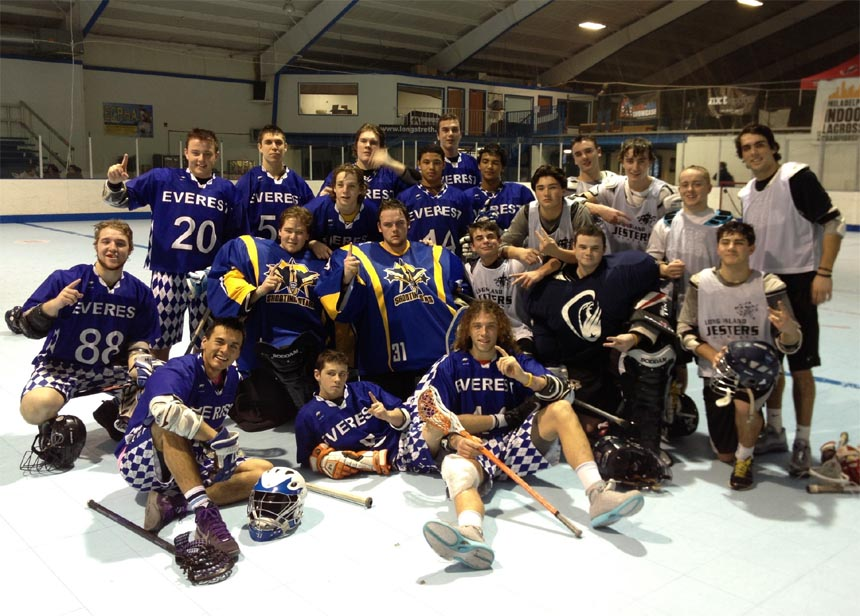 Everest Academy (Ontario, Canada) in blue shirts and Long Island Jesters pose for a group shot after Everest toppled the Jesters 14-5, in the PILC title game at the Sportsplex on Saturday night. the event was hosted by NXTsports with the Education Partner American Indoor Lacrosse Association and CEO-Wings Coach/GM Johnny Mouradian as guest clinician.