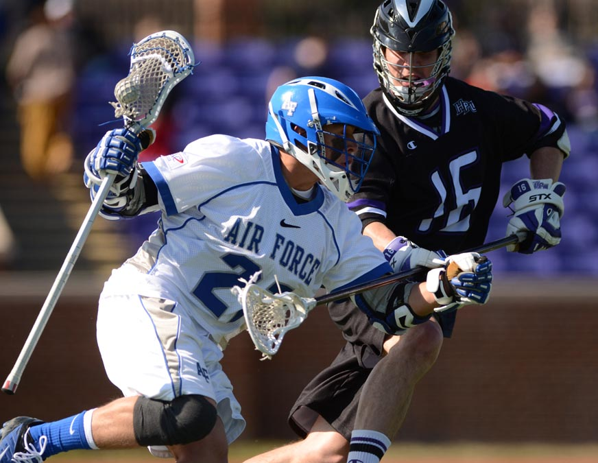 Air Force attackman Keith Dreyer (Malvern Prep) is defended by High Point defenseman Pat Farrell (St. Joseph's Prep) during Sunday's game won by Air Force, 14-4. Dreyer had three assists.