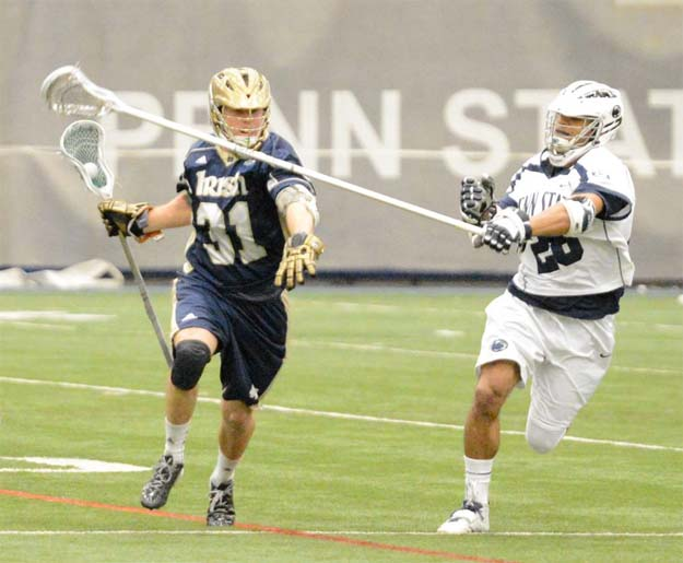 Notre Dame's Liam O'Connor (Haverford School) is defended by PSU's Kessler Brown (For Phillylacrosse.com)