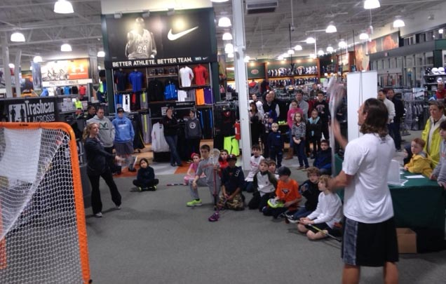 Brett Manney (front, right) and Kelly Barnes (back, left) gave a clinic to youths Wednesday at the Dick's Sporting Goods in Oxford Valley