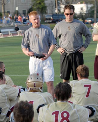 John Nostrant (left) gives instructions to Haverford School players