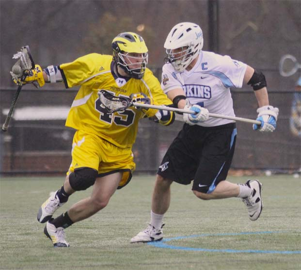 Johns Hopkins All-America defenseman Tucker Durkin (right) defends during the Blue Jays' win over Michigan. (Photo by Rene Schleicher)