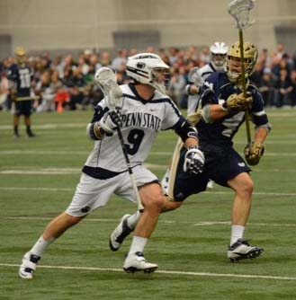 Notre Dame's Stephen O'Hara (St. Joseph's Prep) defends PSU's Jack Forster (La Salle) during Sunday's OT thriller (For Phillylacrosse.com)