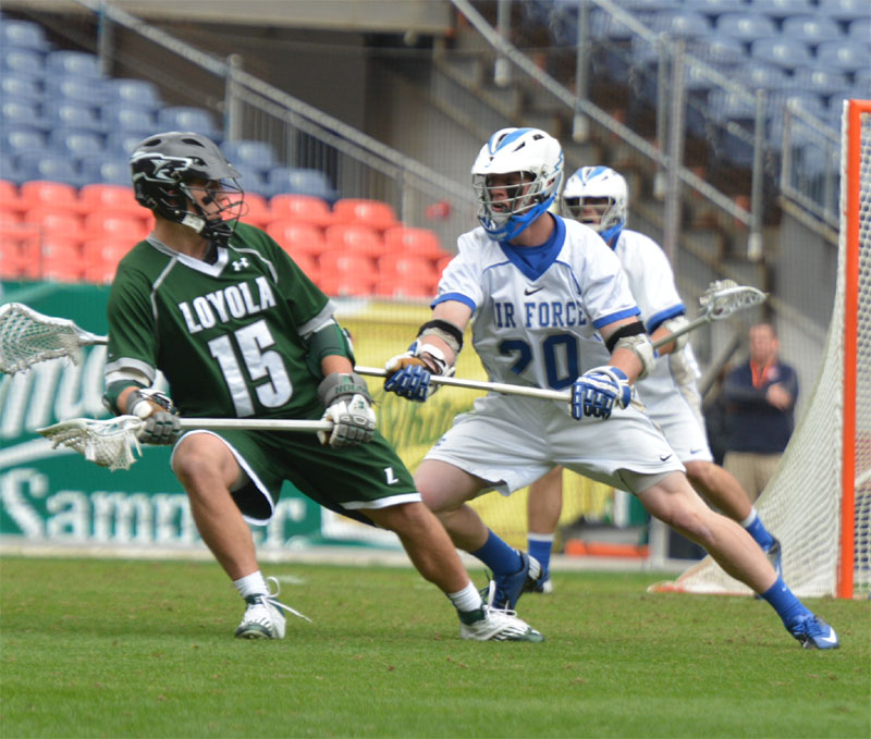 Air Force freshman defenseman Alex warden (Garnet Valley) defends Justin Ward of Loyola during Saturday's game