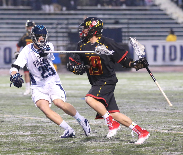 Maryland attackman Bradlee Lord (Conestoga) is defended by Villanova's Christian Kolderup during Saturday's night's game (Photo by Rene Schleicher)