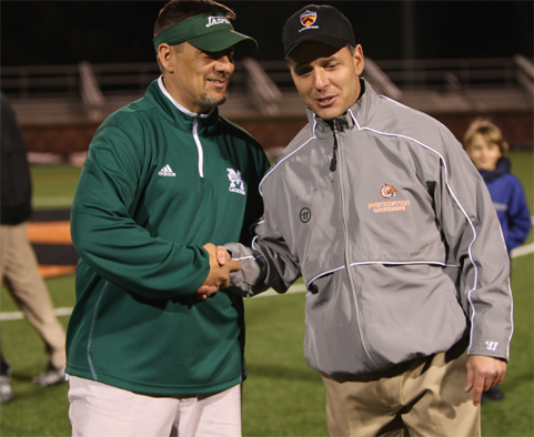 Princeton's Chris Bates (right) is congratulated by Manhattan head coach Steve Manitta after Princeton's 15-2 win Tuesday night. It was the 100th win of Bates' career, with 70 at Drexel and 30 at Princeton. (Photo courtesy of Princeton Sports Information)