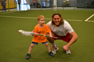 Brett Manney of the Philadelphia Wings working with a young Cradler at Cradle Bucksmont