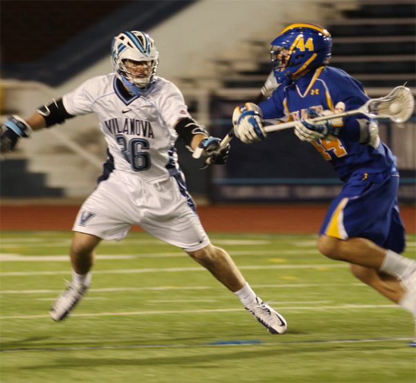 Villanova's Mark Jackson (Malvern Prep) defends Delaware's Brian Kormondy during the 'Cats' 14-9 victory (Photo by Rene Schleicher)
