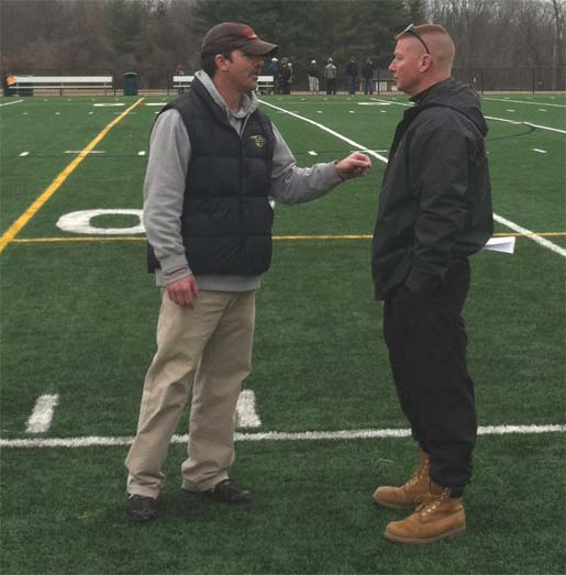 Haverford coach John Nostrant congratulates St. Paul's coach and close friend Rick Brocato after the Crusaders won 11-8 on Saturday