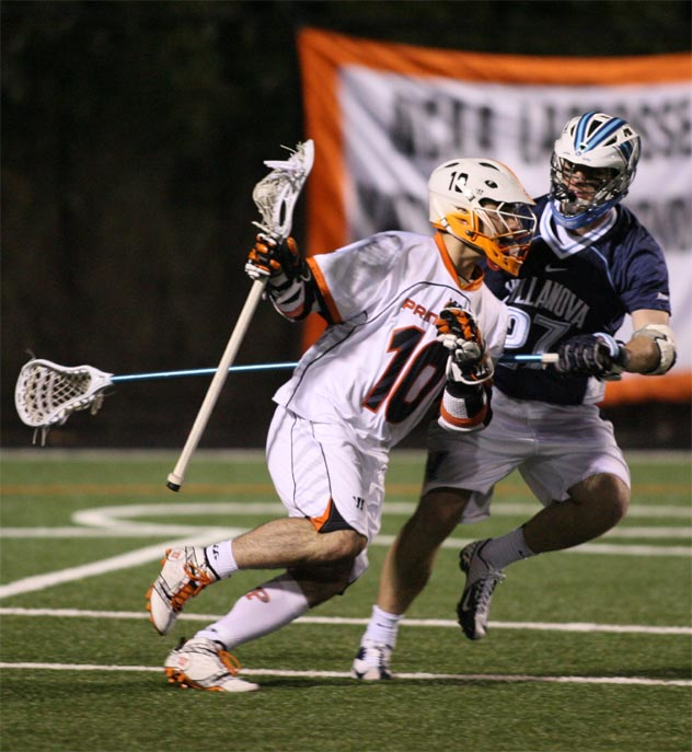 Princeton's Jeff Froccaro is defended by Villanova's Christopher Conway of villanova