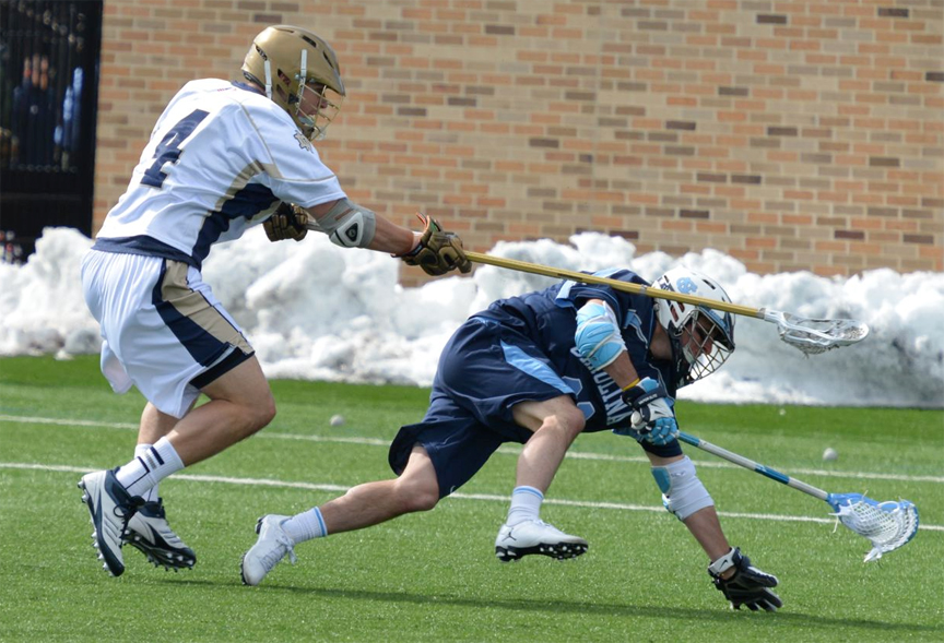 Notre Dame's Stephen O'Hara (St. Joseph's Prep) defends Joey Sankey (Penn Charter) in the Irish victory (Photo for Phillylacrosse.com)