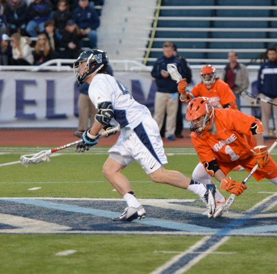 Villanova's Thomas Croonqust (left) won 22 of 24 face-offs to lead the upset win (Photo for Phillylacrosse.com)