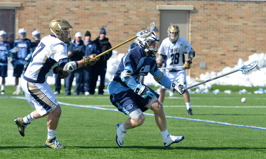 Notre Dame's Tyler Andersen (Radnor) defends UNC's Ryan Kilpatrick (Salesianum School) - (Photo for Phillylacrosse.com)
