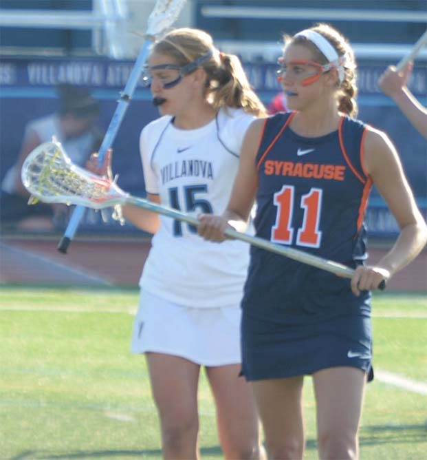 Syracuse's Amy Cross (Upper Dublin, front) and Villanova's Hannah Goforth (Bishop Shanahan) squared off in Friday's BIG EAST contest. Each player scored once in the Orange victory.