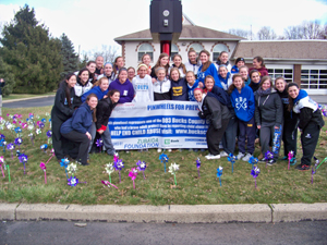 CB South girls lacrosse team plant pinwheels for Child Abuse Prevention Month.