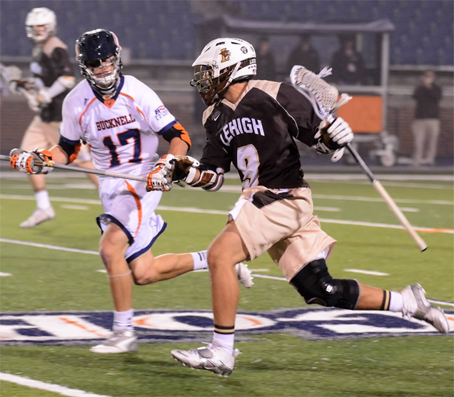Lehigh senior attackman, seen here in an earlier game vs. Bucknell defenseman Jackson Place (Episcopal Academy), is a key for the Mountain Hawks as they gear for today's Patriot League championship game vs. Place and the Bison Dante Fantoni - Jackson Place