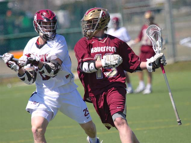 Haverford School's Drew Supinski is defended by Radnor's Peter Donato in Saturday's game (Photo for Phillylacrosse.com)