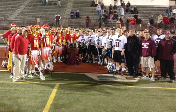 West Chester East (left) and Henderson teams come together to honor Drew Bauer's memory