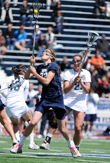 Georgetown's Kelyn Freedman (Radnor grad) goes for a draw control in the Hoyas' 6-5 win over Villanova (Photo by Tim Flatley)