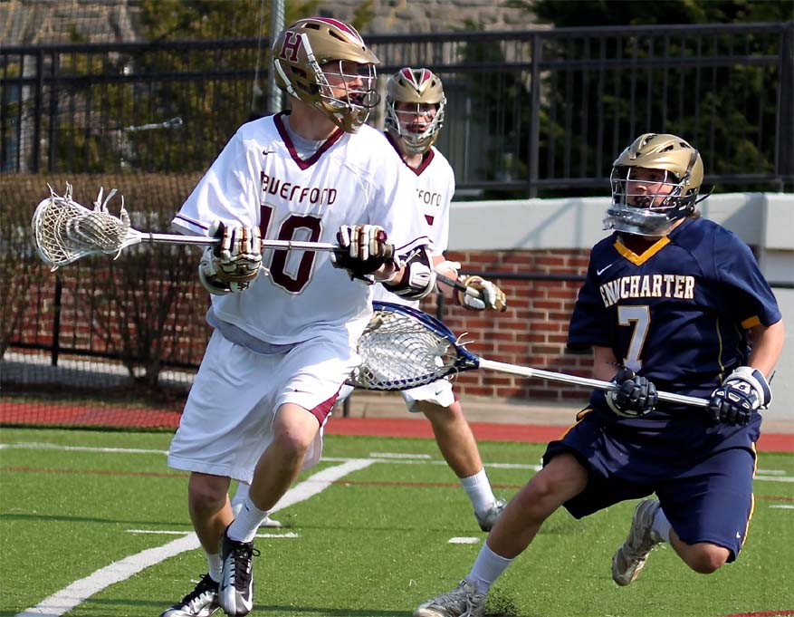 Haverford School's Kip Taviano shoots on Penn Charter's Sean McKee (Photo for Phillylacrosse.com)