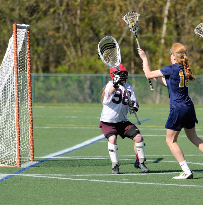 Agnes Irwin's Lila Barker shoots on Abington's Kate Margolis during Saturday's 12-10 win by the Owls (Photo by Tim Flatley)