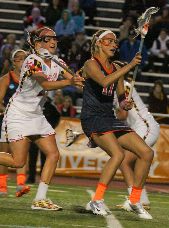 Syracuse's Amy Cross (right, Upper Dublin), receives a pass during Friday's heartbreaking 11-10 loss to Maryland in the NCAA semifinals (Photo by Rene Schleicher)