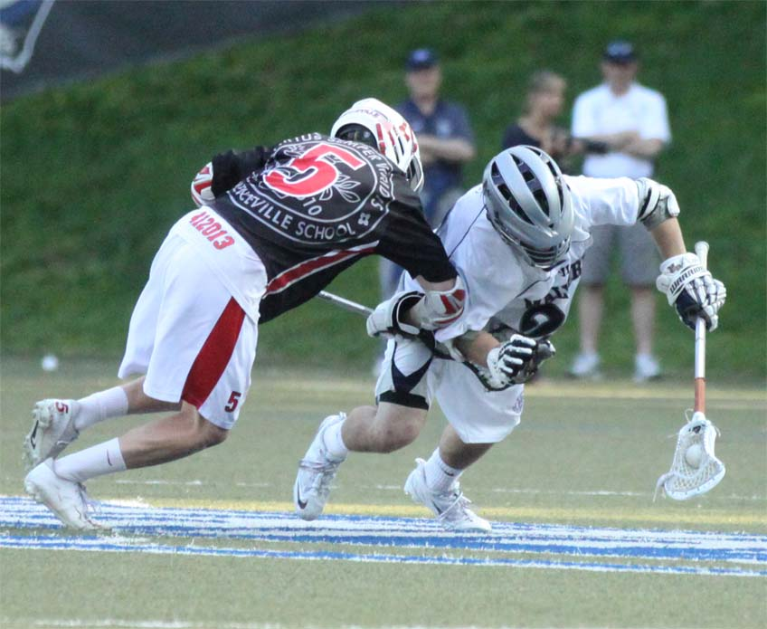 Malvern Prep's Charles Kelly, the YBH-Audi Volkswagen Player of the Game, wins a draw vs. Stephen Clarke in Monday's 11-7 semifinal victory over Lawrenveille in the Inter-Ac Invitational semis (Photo by Rene Schleicher)