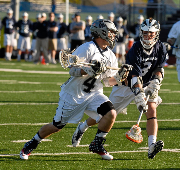 Malvern Prep's Chris Hilburn is defended by Episcopal Academy's Ian Strain in Friday's Inter-Ac game (Photo by Warren Samolsky)