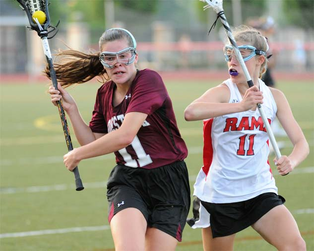 Conestoga's Blake Hamblett is defended by Harriton's Maura Henderson during Wednesday's PIAA contest