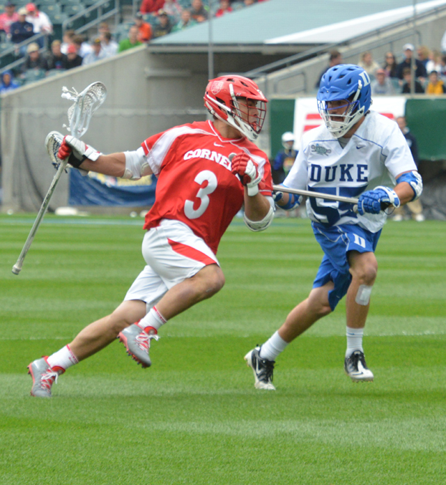 Duke's Billy Conners (Malvern Prep) defends Conell star Rob Pannell during Saturday's 16-14 victory