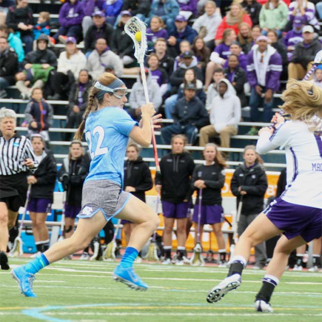 North Carolina's Emily Garrity (Strath Haven) storms downfield in Friday's 11-4 conquest of Northwestern in the NCAA Division i semifinals (Photo by Rene Schleicher)
