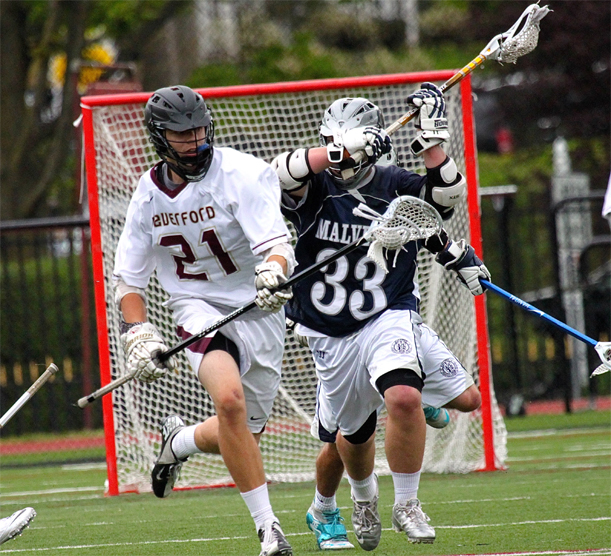 Haverford School defenseman Noah Lehman tries to head upfield with Malvern Prep's Ryan Hilburn riding (Photo for Phillylacrosse.com)