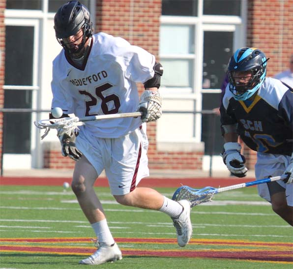 Jake Hervada wins a face-off for Haverford School in its victory over Springside Chestnut Hill Academy (Photo for Phillylacrosse.com)