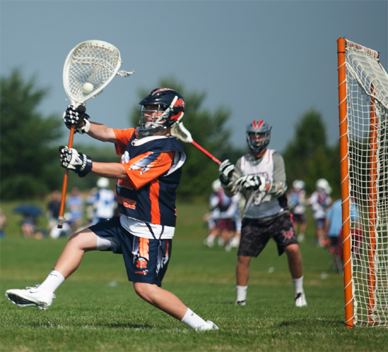 Manhasset 32 goalie John Young (rising senior at Manhasset High) makes a big save in action at the Summer Slam Saturday (Photo by Jacob Farrell)