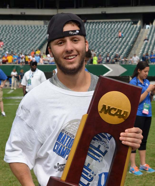 Duke's Jordan Wolf (Lower Merion) celebrates the 2013 Division I National Championship
