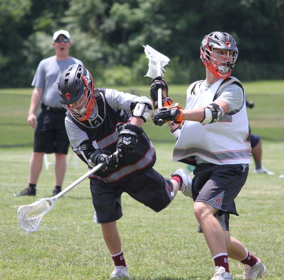 Defenseman Matt Schwartz (right) of Phillie Elite and Archbishop Wood, makes a big hit during Friday's Adrenaline Black Card Showcase