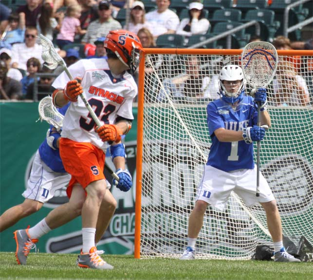 Syracuse's Scott Loy shoots on Kyle Turri