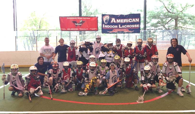 Johnny Mouradian, Head Coach/GM of the Philadelphia Wings and President of the American Indoor Lacrosse Association (top row far right) poses for a team picture with campers and his staff Ryan and Joey Sankey, Jordan Wolf and Bobby Hill.