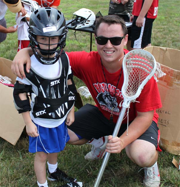 Boyertown rising senior Brock Johnson, seen with rising 1st grader Mason Heydt, ran a free two-day clinic along with his high school teammates for youth players in his community