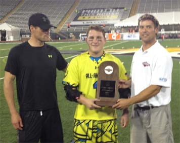 la Salle's Matt Rambo receives MVP award from Lee Corrigan (right)