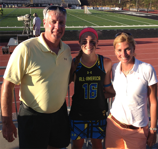 Alex Poplawski (center) poses with mother Chrissy and father Mark after helping the North win, 18-16, inthe Under Armour Senior All-American Game at Towson University