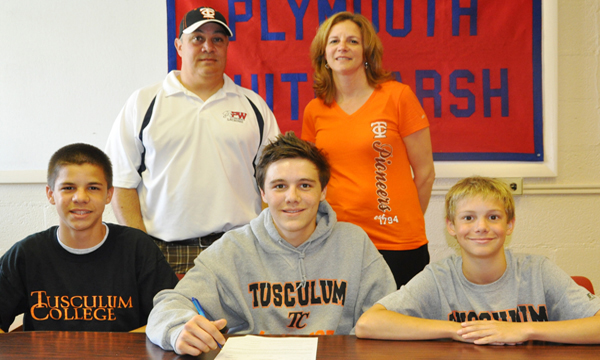 Ryan Kelly signs with Tusculum with his family on hand