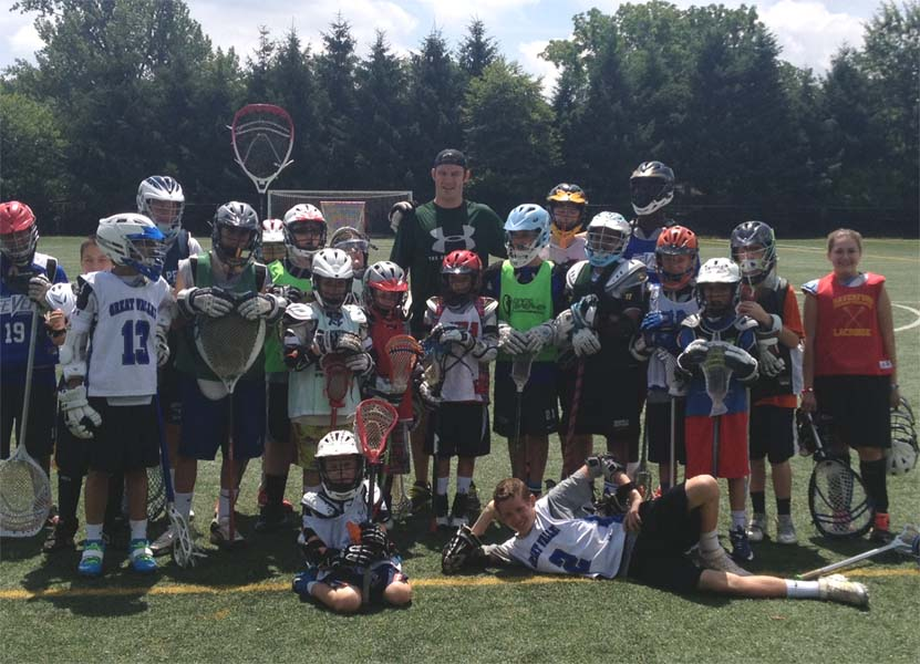 MLL All-Star Kevin Crowley (back), seen here at a previous camp, is a coach at GameBreaker Camps