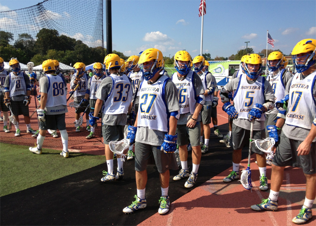 Hofstra senior Anthony Zappone (27) leads his team to the field as it gears for the Pride's first game today at the Nick Colleluori Classic. Zappone was named with the honor of wearing Nick Collelouri's No. 27 for the 2014 season by coach Seth Tierney for his Relentless attitude.