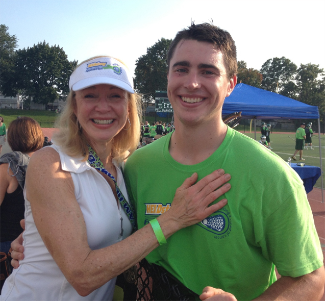 Binghamton senior defenseman Garrett Augustyn huigs his mother Kathie at the 7th Annual Nick Colleluori Classic on Saturday at Ridley. Augustyn and his mother lost his brother, Michael, to non-Hodgkin's Lymphoma exactly 18 years ago today.