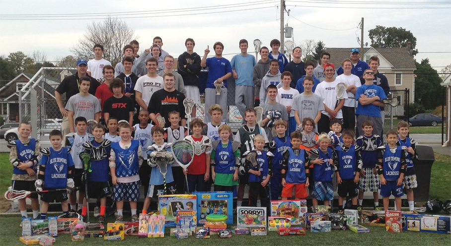 Kennett's boys' lacrosse team, with much community support, will bring over 70 toys to needy children after its Toys for Tots youth clinic
