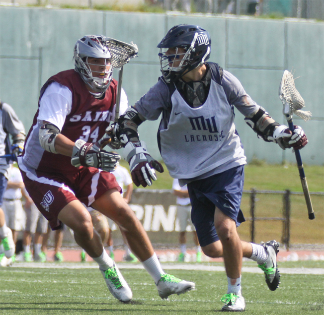 Monmouth freshman Zack Scleicher (right) is defended by St. Joseph's freshman Jarred Wolf (Downingtown West) in Saturday's Nick Colleluori Classic. Monmouth made its Division I debut in the Fall Ball classic.